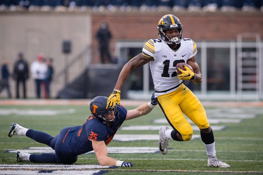 Illinois linebacker Jake Hansen misses a tackle on Iowa wide receiver Brandon Smith during Illinois' game against Iowa at Memorial Stadium on Nov. 17, 2018. Last year, the Illini lost to the Hawkeyes in a 63-0 shutout, tying the school's largest margin of defeat in history.
