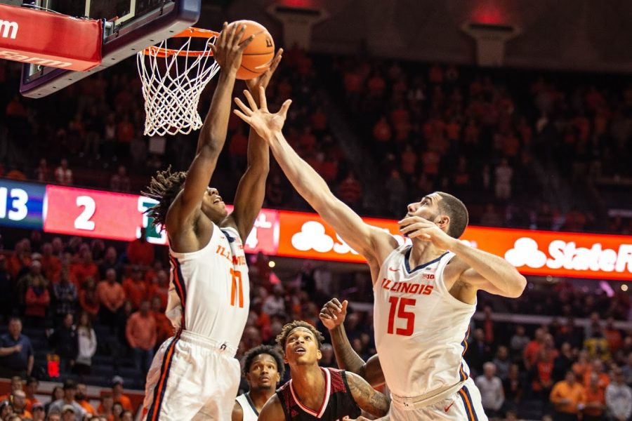 Giorgi+Bezhanishvili+and+Ayo+Dosunmu+jump+for+an+offensive+rebound.+Illinois+faced+Nicholls+State+at+the+State+Farm+Center+on+Nov.+5+and+won+78-70.