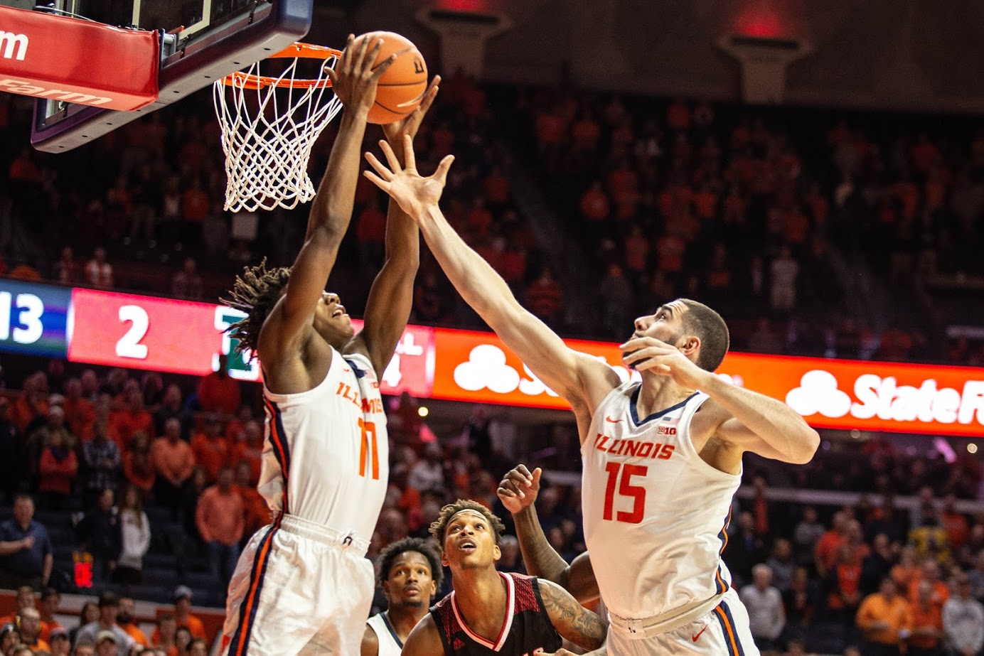 Giorgi Bezhanishvili and Ayo Dosunmu jump for an offensive rebound. Illinois faced Nicholls State at the State Farm Center on Nov. 5 and won 78-70.