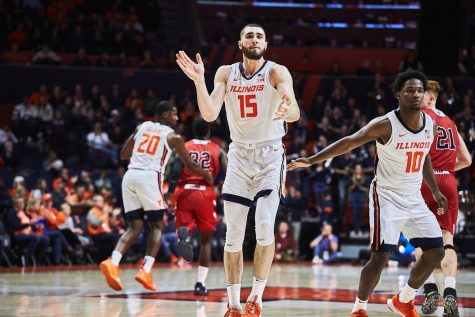 Giorgi Bezhanishvili (15) celebrates after the Illini score at State Farm Center on Friday. Despite a slow start against Lewis in Friday's exhibition, Illinois pulled through with 83-50 win.