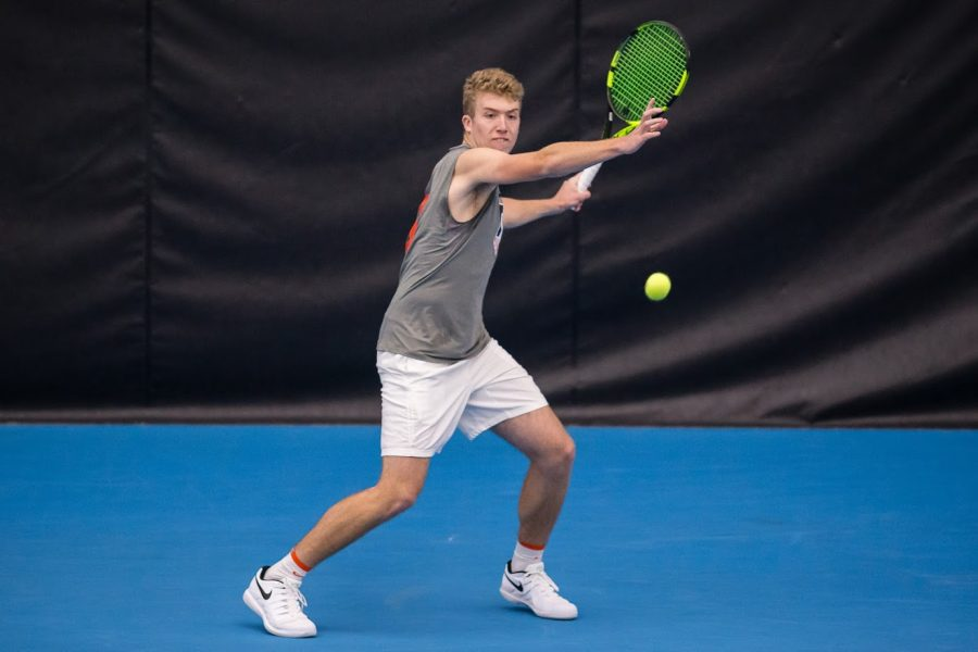 Junior Alex Brown gets returns the ball during Illinois' match against Duke at the Atkins Tennis Center on Feb. 1. On Saturday, the Illini hosted their annual JSM Challenger of Champaign-Urbana where they hosted players from around the world in Champaign.