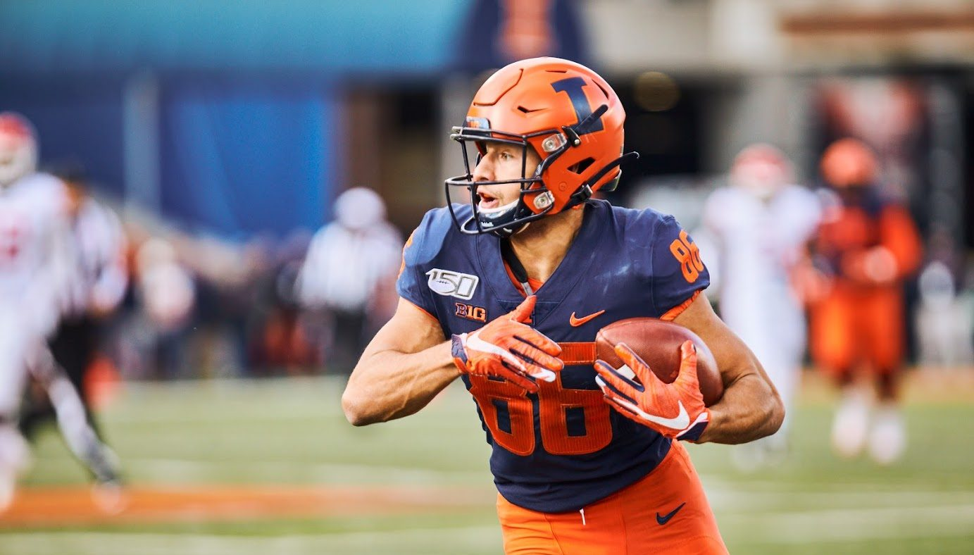 Sophomore wide receiver Donny Navarro carries the ball at Illinois' game against Rutgers at Memorial Stadium Saturday. Navarro emerged off of Illinois' bench as a main contributor during the Homecoming game against Wisconsin, where he caught a slant pass and broke free for a 48-yard touchdown.