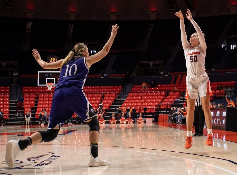 Ali Andrews pulls up for a three pointer at the Illini's game vs. Holy Cross at the State Farm Center on Nov. 10.