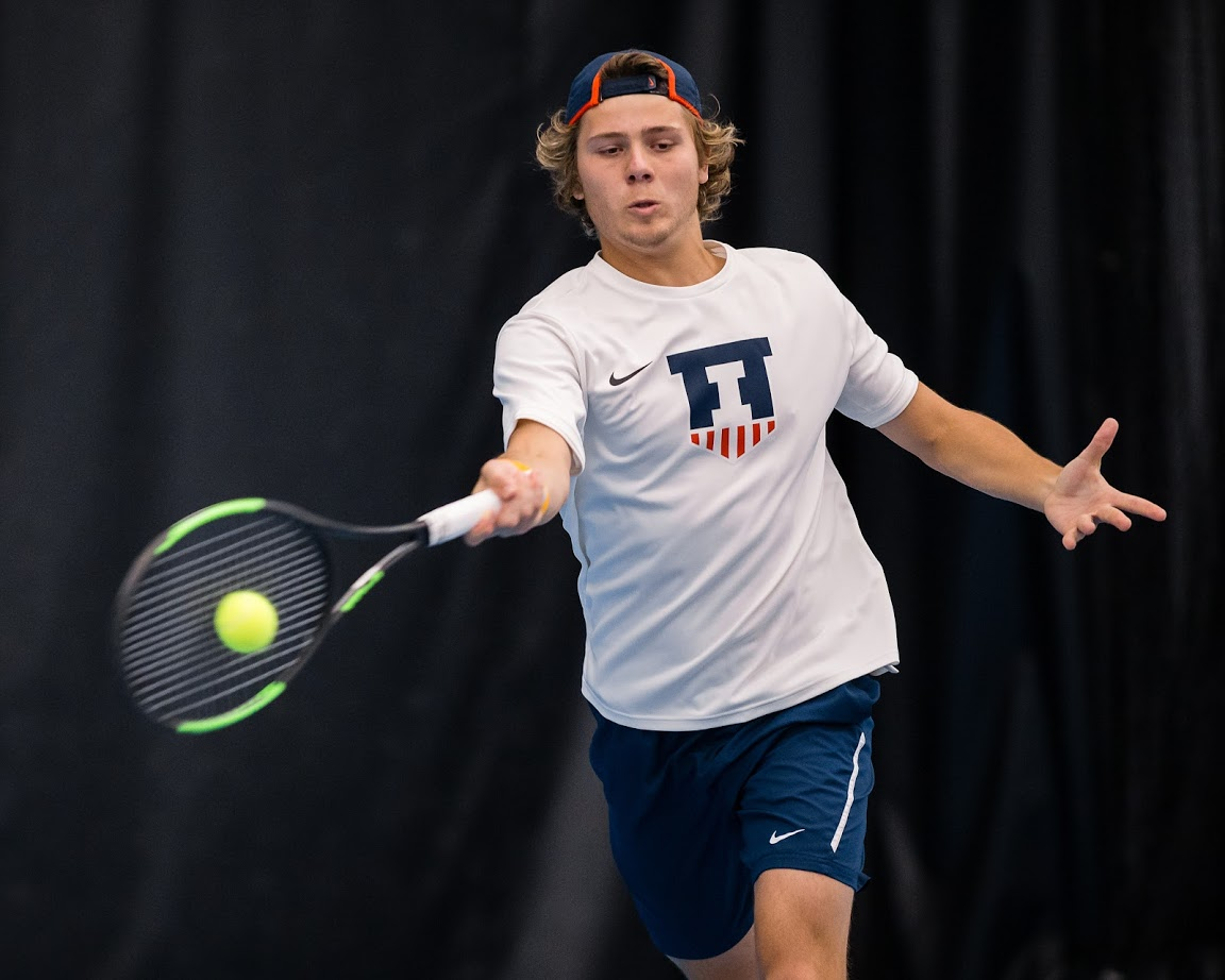Illinois' Aleks Kovacevic returns the ball during the match against Penn State at Atkins Tennis Center on Friday, April 12, 2019. The Illini won 4-3.