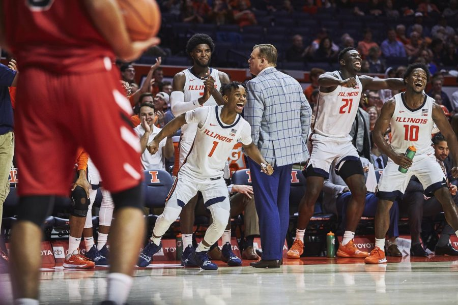 The Illinois bench celebrates during the Illini's game against the Lewis Flyers. Illinois beat Lewis 83-50 in the team's first exhibition game of the season. Jonathan Bonaguro The Daily Illini.