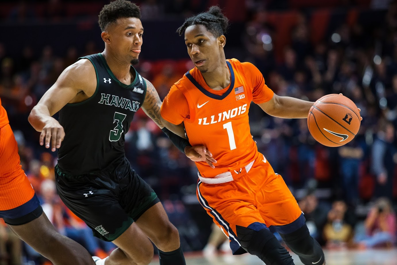 Trent Frazier drives past a Hawaii defender at the Illini's game vs Hawaii at the State Farm Center on Monday.