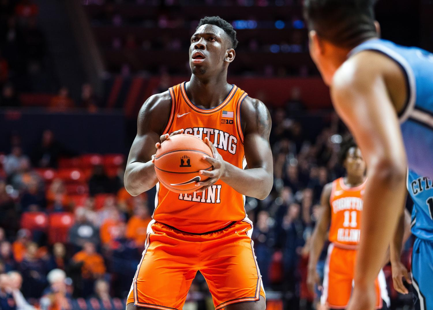 Freshman center Kofi Cockburn shoots a free-throw at the line during Illinois' game against the Citadel at the State Farm Center Nov. 20. Cockburn's fourth double-double in five games helped lead the Illini past the Bulldogs 85-57 on Wednesday night. Captured at State Farm Center on 20 Nov, 2019 by Jonathan Bonaguro.