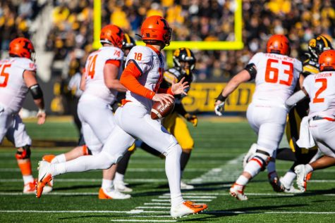 Illinois quarterback Brandon Peters rolls to the right and looks for an open receiver during Illinois' game at Iowa Saturday. The Hawkeyes beat the Illini 19-10, snapping their four-game win streak. Captured at Kinnick Stadium on 23 Nov. 2019 by Jonathan Bonaguro.