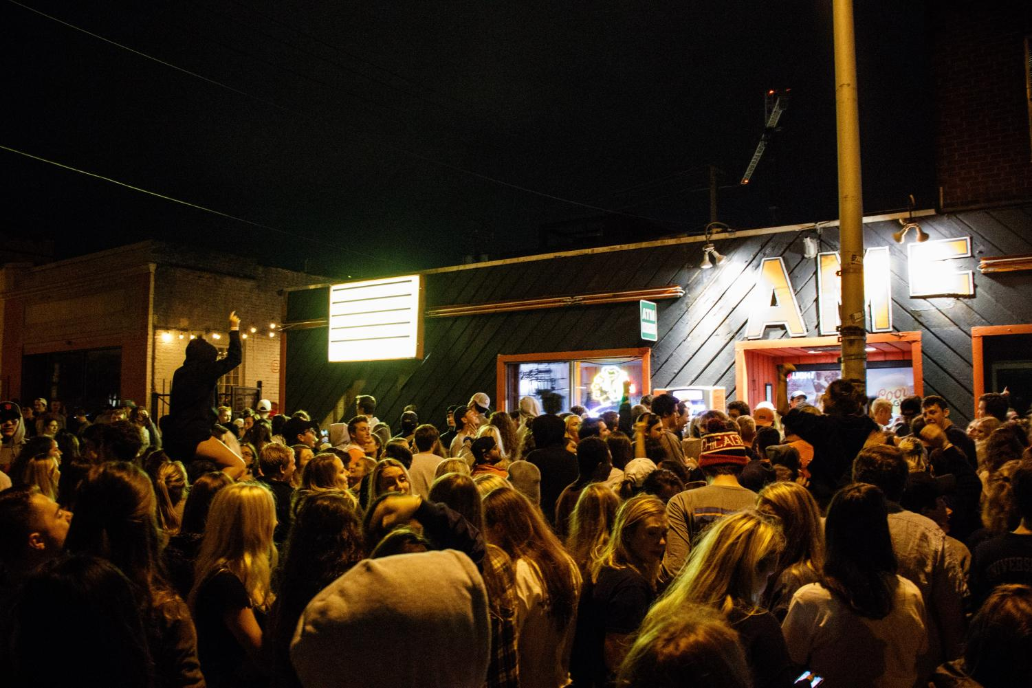 Patrons of KAM's gather outside the historic bar during its final hours on Oct. 20. The last call at KAM's was one of the top five moments of the semester, as selected by The Daily Illini staff.