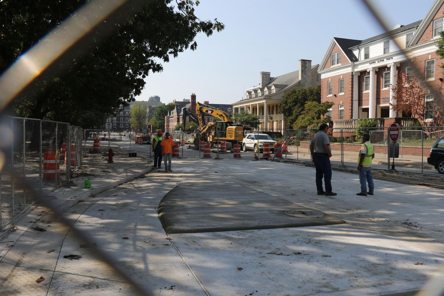 Workers look over construction near the corner of Wright and John streets on Sept. 20.