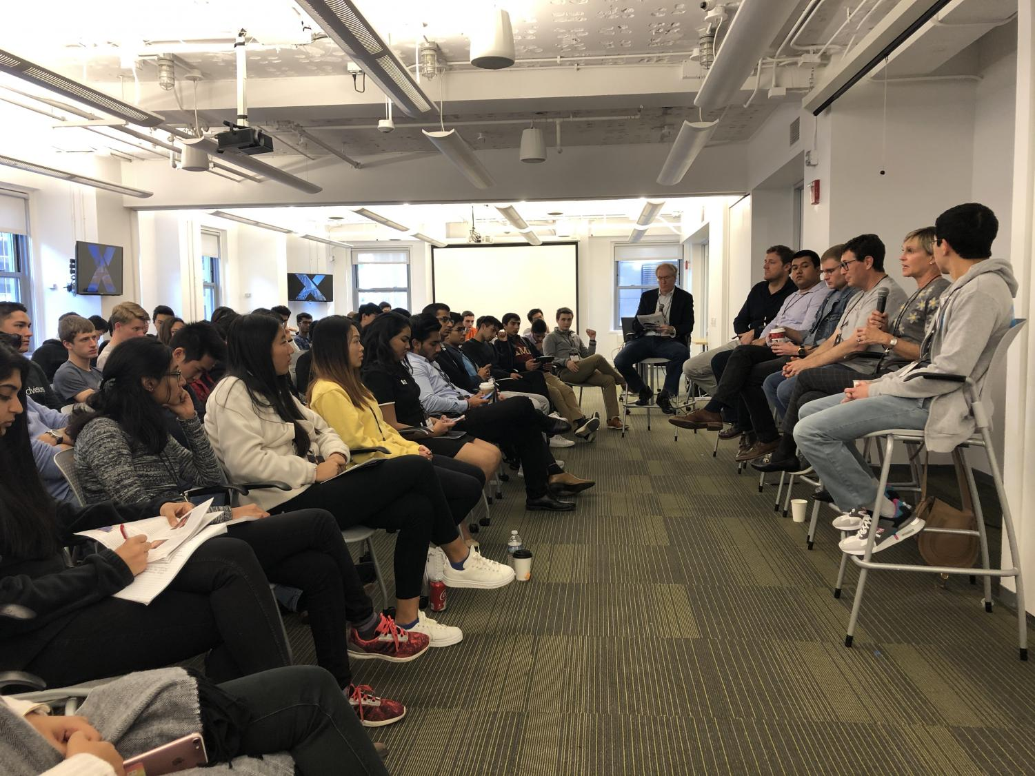 A group of Midwestern students listen to a panel of venture capitalists at the Forge Startup Weekend. Mark Van den Avont, junior in Engineering, received first prize at the event.