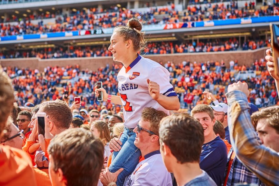 Illinois fans rush the Memorial Stadium Field after Illinois upset Wisconsin on Oct. 19. The average attendance for Illinois home games has dropped from 45,644 in 2016 to 36,702 in 2019, according to the University of Illinois Division of Intercollegiate Athletics.
