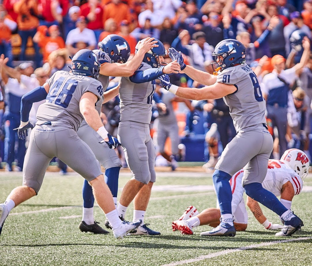 The Illinois football team celebrates with kicker James McCourt after he scored a field goal during the Illinois' game against No. 6 Wisconsin. Illinois and California will go head-to-head in the Redbox Bowl Monday at 3 p.m. CT in Santa Clara, Calif.