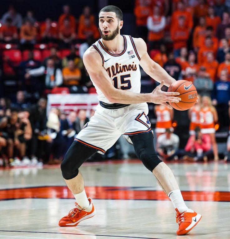 Sophomore+Giorgi+Bezhanishvili+dribbles+from+behind+the+arc+during+Illinois%E2%80%99+game+against+Miami+at+State+Farm+Center+Monday.+Illinois%E2%80%99+fell+to+Miami+81-79.+Bezhanishvili+is+adapting+to+his+new+role+as+power+forward.+