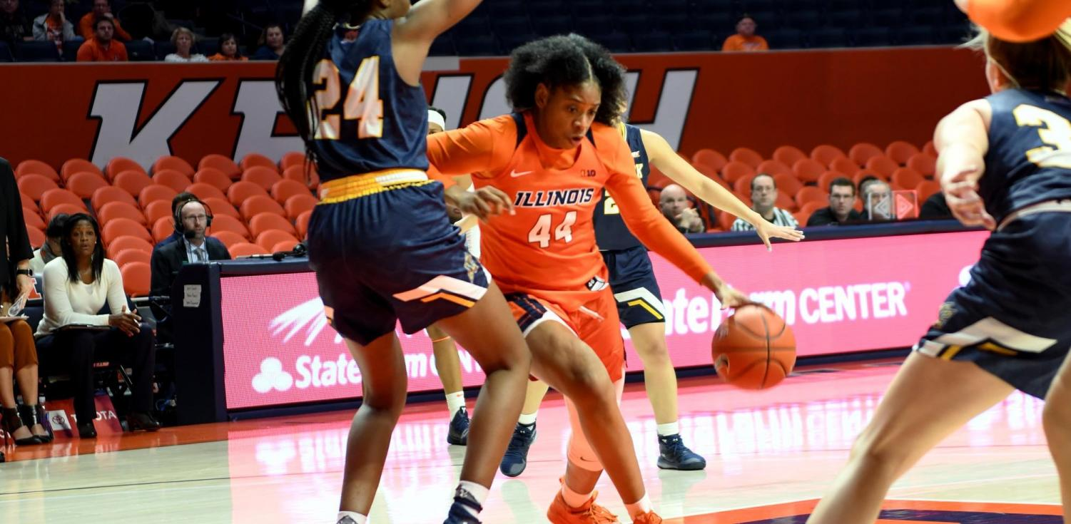 Kennedi Myles drives past a Merrimack defender during Illinois' game against Merrimack at State Farm Center on Tuesday.