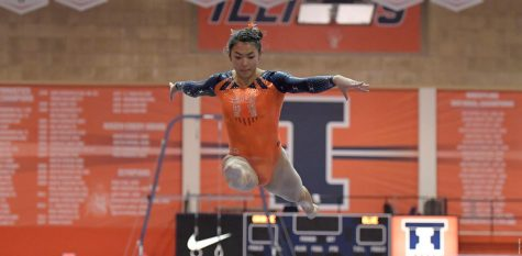Mia Takekawa performs on the balance beam during the Womens' Gymnastics Exhibition against Illinois State at Huff Hall on Thursday. While exhibitions do not count toward a team's record, the event allowed an opportunity for the team to be judged.