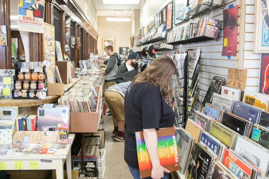 Patrons of Exile on Main Street shop for vinyl records on April 13.