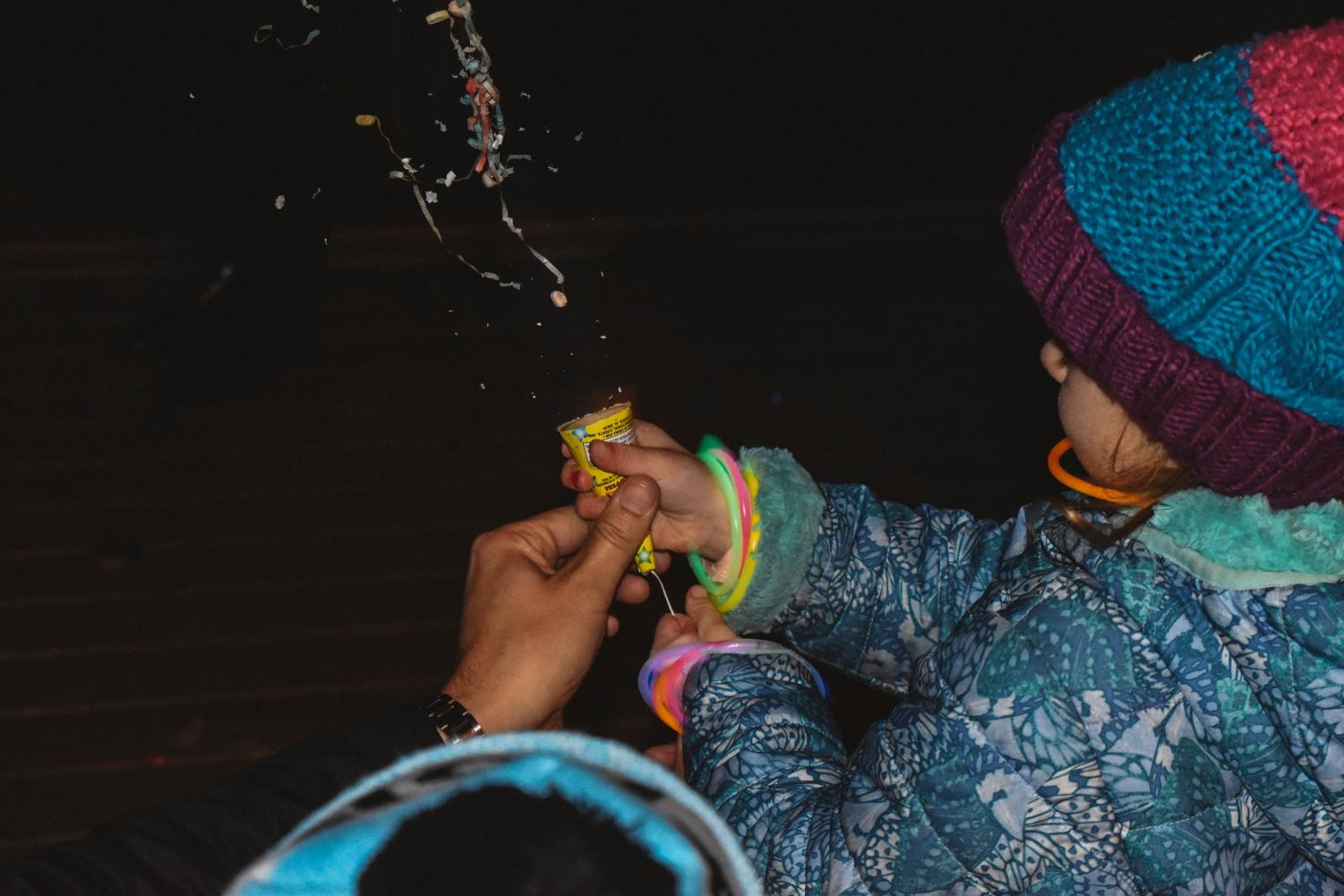 A child uses a party popper at midnight on New Year's Day 2019. As a college student, there are many options for a New Year's resolution to make the most of your college experience.