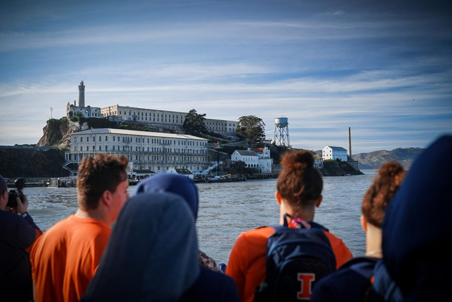 A group of Illini football players look onto Alcatraz Island before visiting the former prison facility as a team on Dec. 27. Photo courtesy of Illinois Athletics.