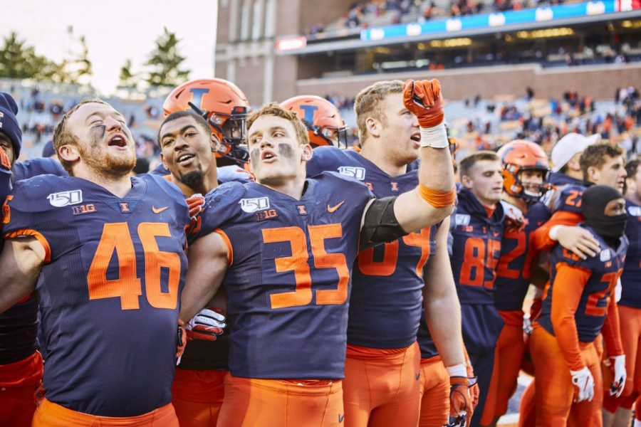 Members of the Illinois football team celebrate after defeating Rutgers 38-10 at home. Captured at Memorial Stadium on 02 Nov. 2019 by Jonathan Bonaguro.