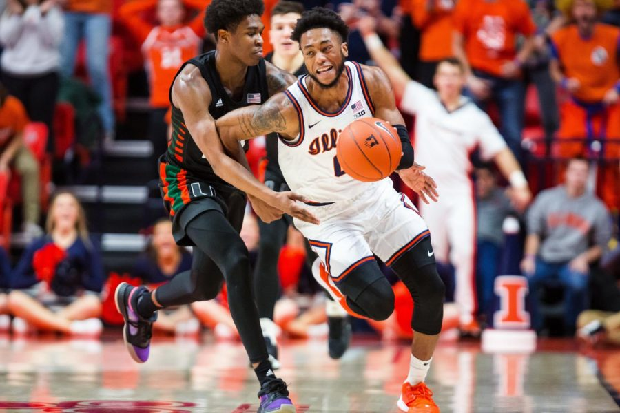 Sophomore+guard+Alan+Griffin+dribbles+past+a+Miami+player+during+the+Illinis%27+game+against+the+Hurricanes+Monday+night+in+the+ACC%2FBig+Ten+Challenge.+Illinois+narrowly+lost+81-79%2C+and+moves+to+6-2+on+the+season+overall.+Captured+at+State+Farm+Center+on+02+Dec.+2019+by+Jonathan+Bonaguro.