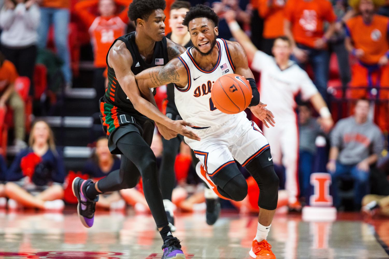 Sophomore guard Alan Griffin dribbles past a Miami player during the Illinis' game against the Hurricanes Monday night in the ACC/Big Ten Challenge. Illinois narrowly lost 81-79, and moves to 6-2 on the season overall. Captured at State Farm Center on 02 Dec. 2019 by Jonathan Bonaguro.