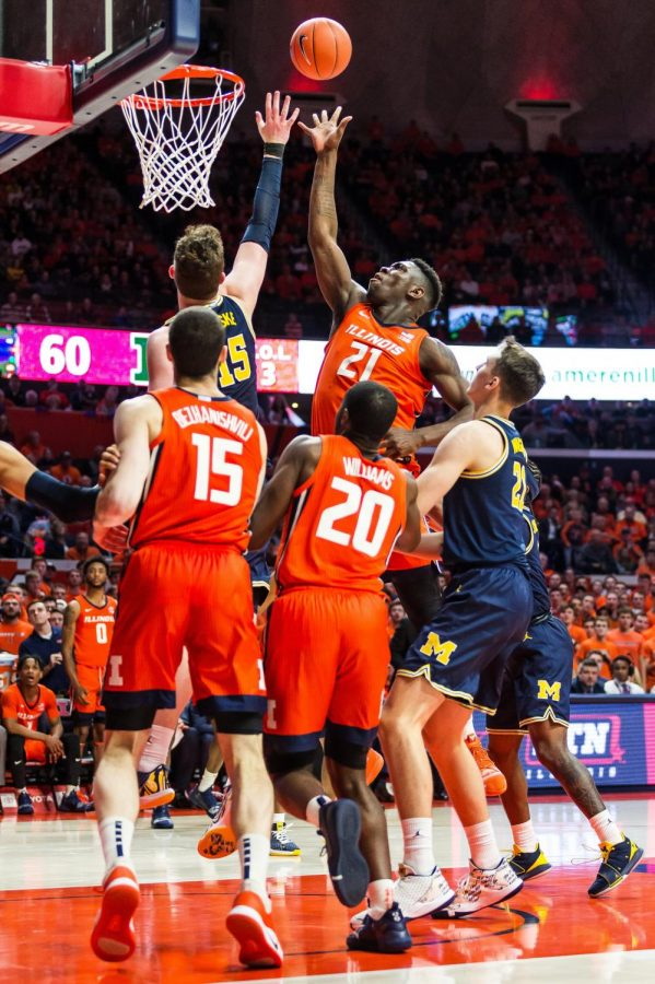 Freshman+center+Kofi+Cockburn+tips+in+a+missed+floater+to+secure+a+30-28+lead+for+the+Illini+at+halftime+during+Illinois%27+game+against+No.+5+Michigan+at+the+State+Farm+Center+Wednesday+night.+Illinois+upset+No.+5+Michigan+71-62%2C+earning+its+first+Big+Ten+win+of+the+season.+Captured+at+State+Farm+Center+on+11+Dec.+2019+by+Jonathan+Bonaguro.