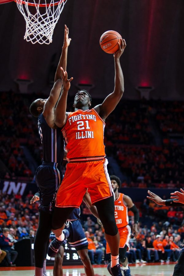 Freshman center Kofi Cockburn rises for a layup during Illinois' game against Old Dominion at the State Farm Center on Dec. 14. Illinois won 69-55. Cockburn scored a career-high 26 points against North Carolina A&T on Dec. 29 at home. The Illini beat the Aggies Sunday 95-64. Photo by Jonathan Bonaguro.