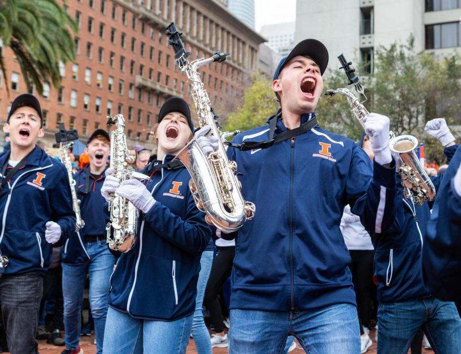 Members of the Illinois Marching Illini shout during the bands performance at a pregame pep rally for the Redbox Bowl on Sunday Dec. 29 in San Francisco. Photo by Jonathan Bonaguro.