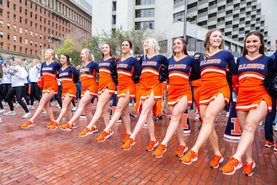 Illinois cheerleaders march during Illinois' pregame pep rally with fans before the Redbox Bowl in San Francisco Sunday.