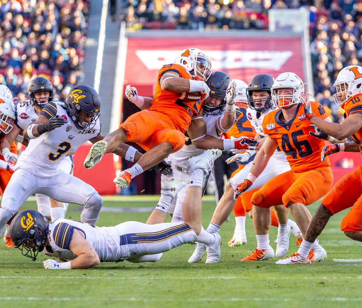 Senior runningback Dre Brown attempts to maintain possession of the ball before getting tackled during the Redbox Bowl in Santa Clara, Calif. Monday. California beat Illinois 35-20 at Levi's Stadium, home of the San Francisco 49ers, in the Redbox Bowl. Photo taken by Jonathan Bonaguro.