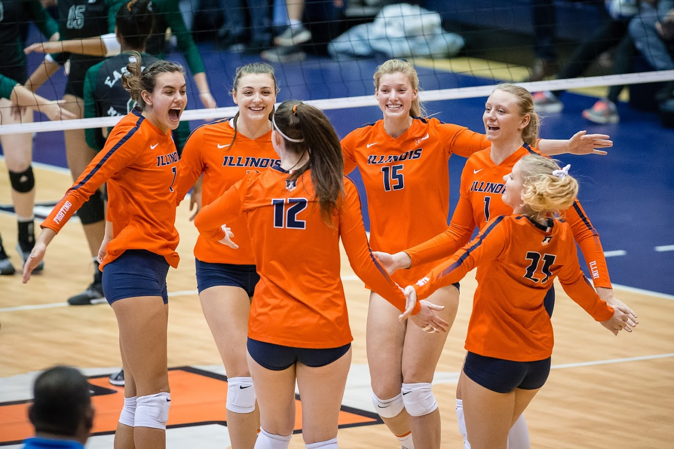 The Illini celebrate after scoring a point during the match against Eastern Michigan in the first round of the NCAA Tournament at Huff Hall on Friday, Nov. 30, 2018. The Illini won 3-0.