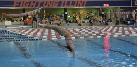 Freshman Erin Young dives at the Rutgers Invitational at the Rutgers Aquatic Center over the weekend.