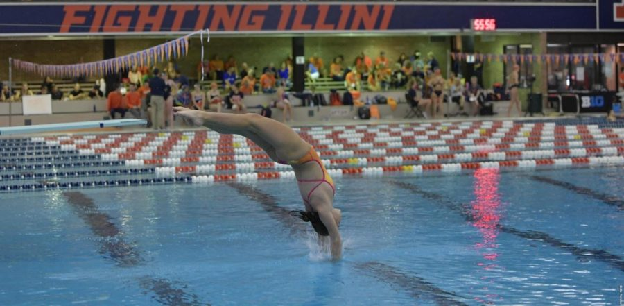 Freshman+Erin+Young+dives+at+the+Rutgers+Invitational+at+the+Rutgers+Aquatic+Center+over+the+weekend.