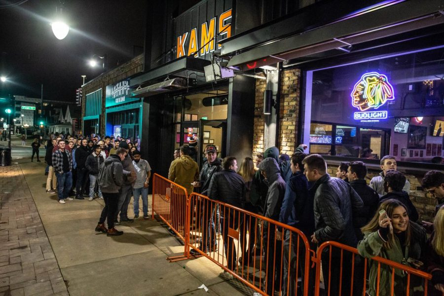 Patrons+stand+outside+KAM%27s+on+Jan.+29+for+opening+night.+A+GroupMe+chat+of+KAM%27s+employees+caused+controversy+across+campus.+KAM%27s+responded+Wednesday+stating+that+an+employee+in+the+chat+was+fired.+