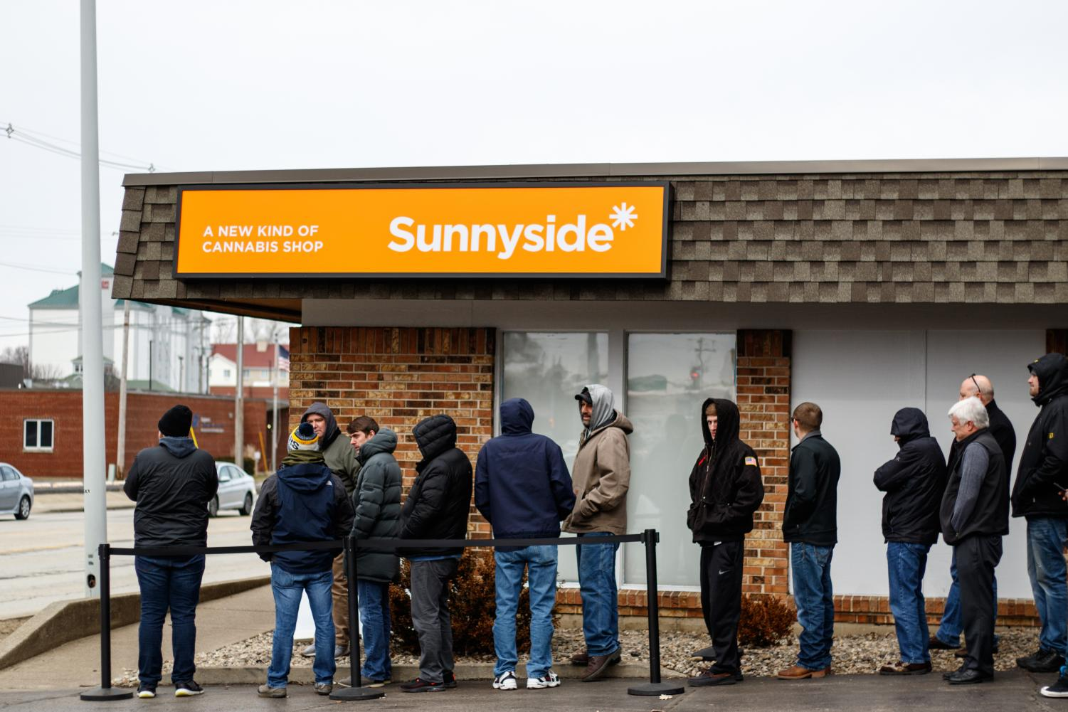 People wait in line at Sunnyside Dispensary on Jan. 22, a cannabis dispensary located on 1704 S. Neil St. Following the legalization of recreational marijuana in the state of Illinois, the C-U community has taken a variety of stances on the topic.