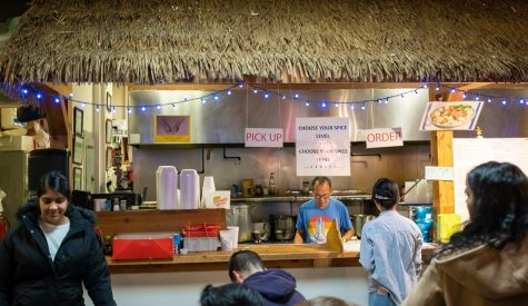 Bangkok Thai worker serves pad thai, good vibes