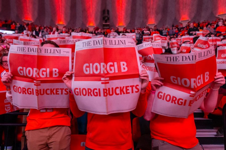 Members+of+the+Orange+Krush+hold+up+the+Orange+Krush+Edition+of+The+Daily+Illini+before+the+game+against+Indiana+at+State+Farm+Center+on+March+7.+Columnist+Tommy+asserts+student-athletes+deserve+support+for+their+dedication.