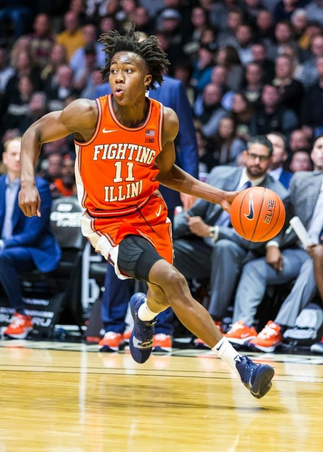 Illinois+Fighting+Illini+guard+Ayo+Dosunmu+%2811%29+dribbles+up+the+court+on+Tuesday+at+Mackey+Arena.+The+Illini+won+79-62.