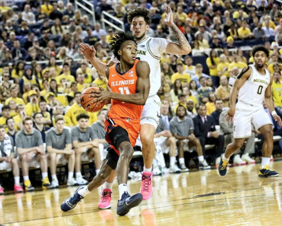 Photo Courtesy of Illini Athletics Guard Ayo Dosunmu drives at the basket during Illinois' 64-62 victory Saturday. Dosunmu scored a career-high 27 points in the win.