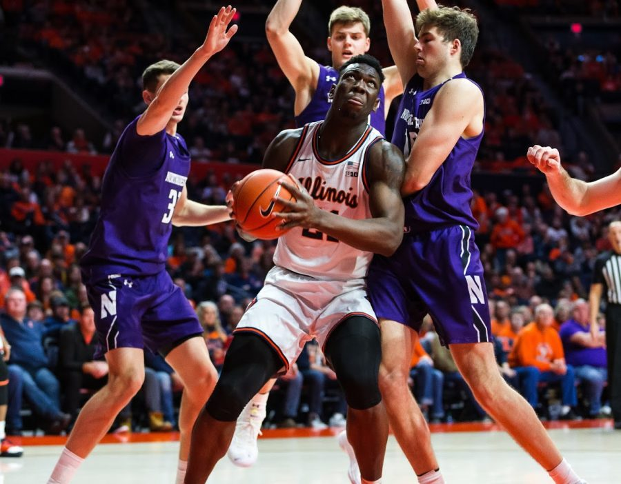 Center Kofi Cockburn prepares a jump shot during a game against Northwestern on Saturday. Illinois won the match 75-71.