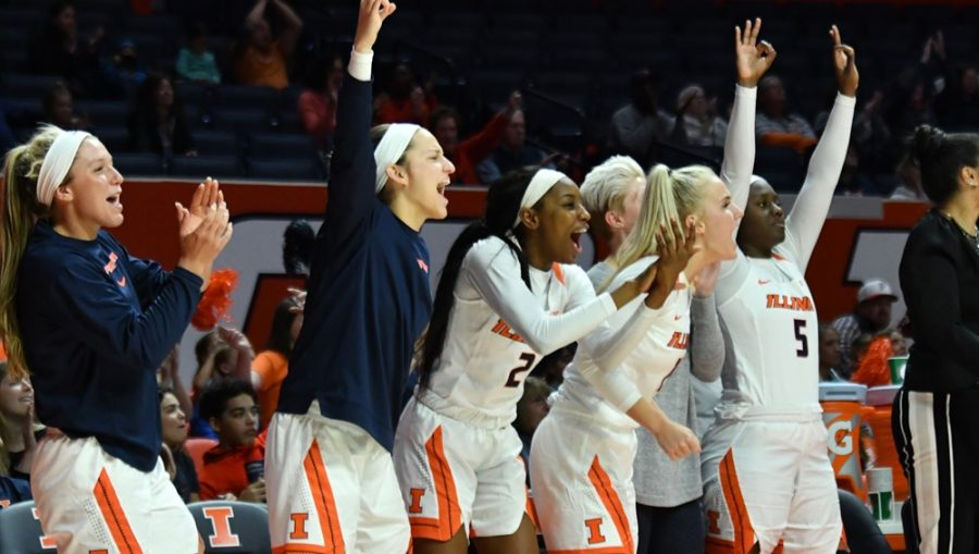Guards Taylor Edwards and Carolyn Waleski cheer with their teammates. The walk-ons were both awarded scholarships in practice in January.