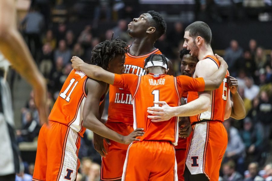 The Illini huddle during their game against the Purdue Boilermakers in West Lafayette, Ind. on Tuesday. No. 21-ranked Illinois won 79-62, clinching the program's first victory at Mackey Arena since 2008. Photo taken by Jonathan Bonaguro of the Daily Illini.