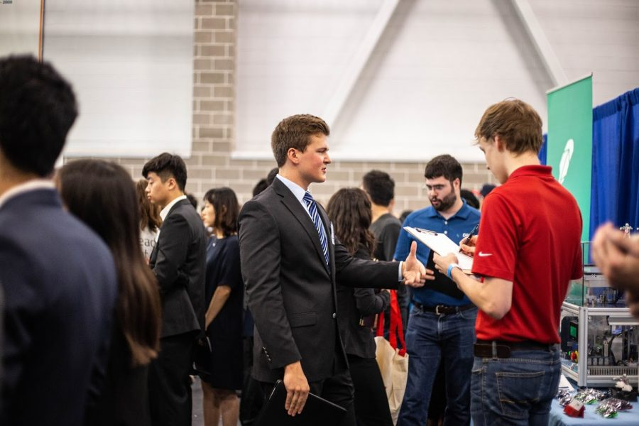 Engineering+students+talk+to+company+representatives+at+the+Engineering+career+fair+at+the+ARC+on+Sept.+11%2C+2018.+Attending+as+many+events+as+possible+strengthens+the+likelihood+of+leaving+a+lasting+impression+on+companies.%0A