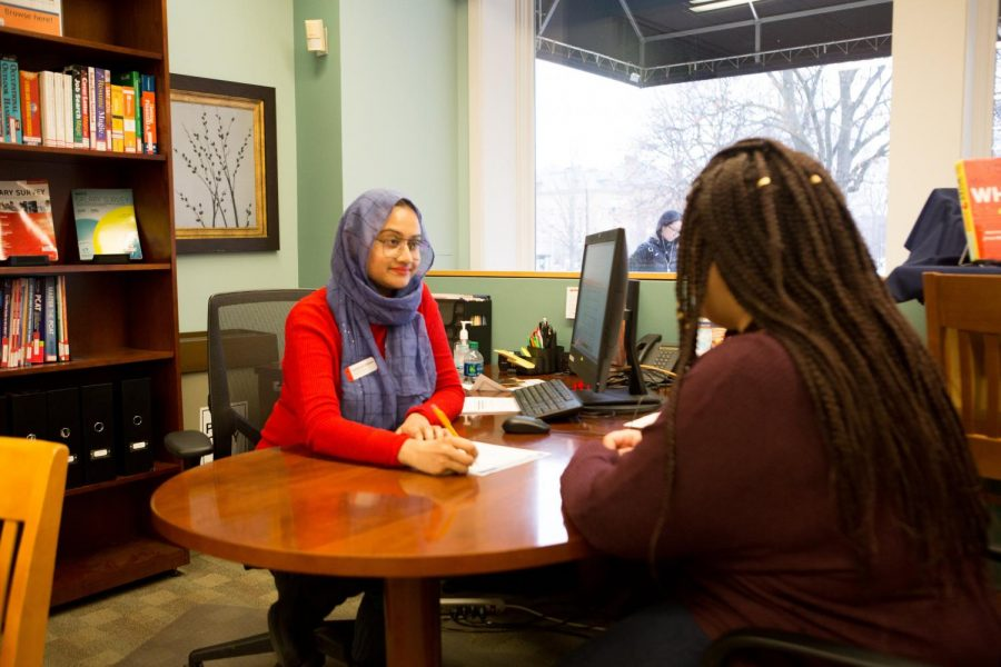 Career Center employee and student, Shoptorshi Rahman, walks through a sample resume with Alexis Young on January 24. Academic advisors are available to assist with student problems.