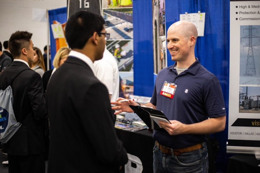 Engineering+students+talk+to+company+representatives+at+the+Engineering+Career+Fair+at+the+ARC+on+Sept.+11%2C+2018.+Reaching+out+and+asking+questions+to+recruiters+can+be+helpful+in+future+job+opportunities.
