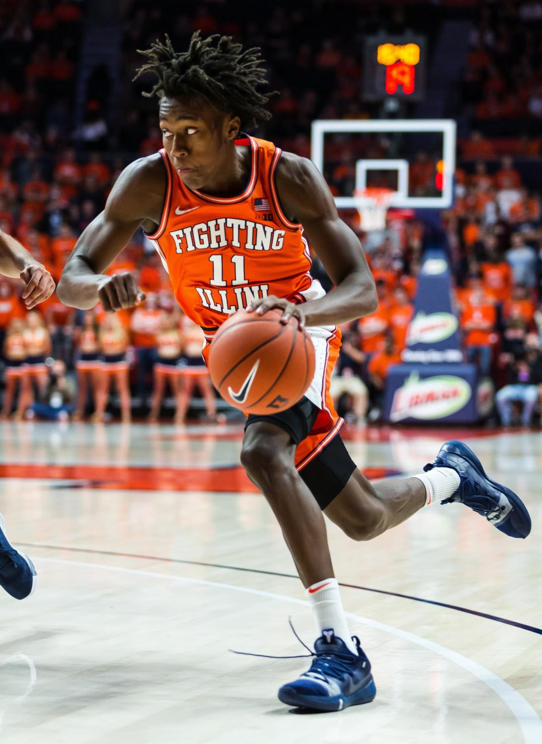 Sophomore Ayo Dosunmu dribbles toward the basket during Illinois' game against Old Dominion at the State Farm Center on Dec. 14. Captured at the State Farm Center on 14 Dec. 2019 by Jonathan Bonaguro.