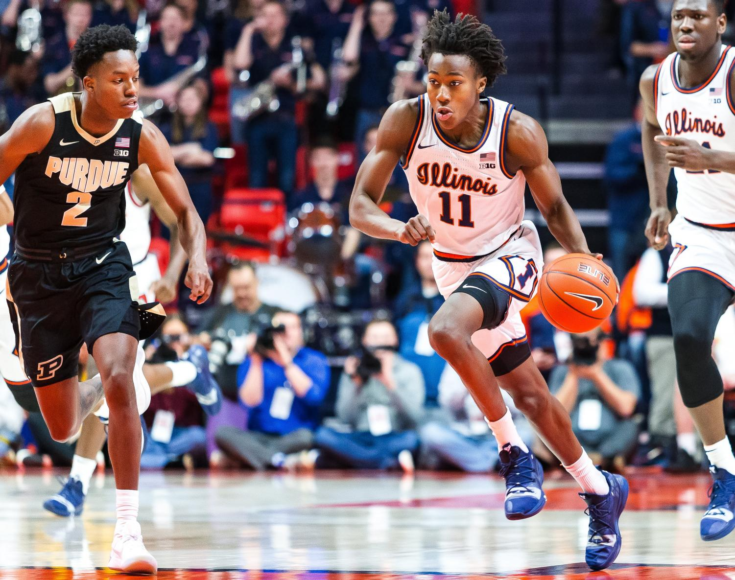 Sophomore Ayo Dosunmu dribbles past a Purdue player during the Illini's game against the Boilermakers at the State Farm Center Jan. 5. Photo by Jonathan Bonaguro.