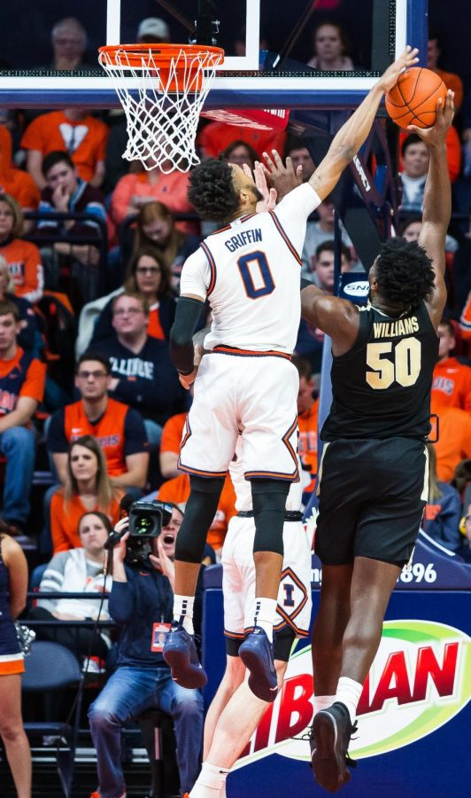 Sophomore+Alan+Griffin+rises+to+block+a+Purdue+shot+during+the+Illini%27s+game+against+the+Boilermakers+on+Jan.+5+at+the+State+Farm+Center.+