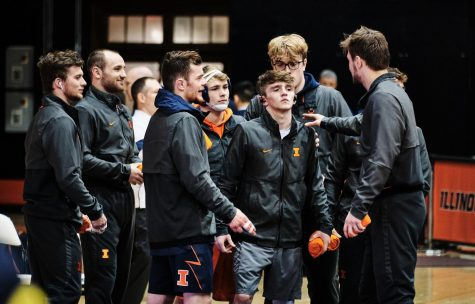 The Illinois Wrestling team cheer for Justin Cardani before his match during the Illinois vs. Michigan dual on Sunday.